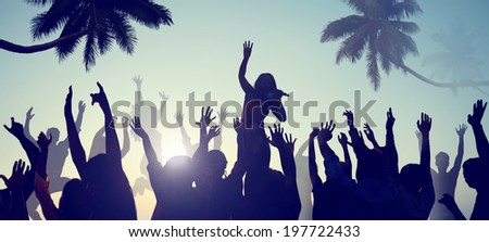 Silhouettes of Young People on a Beach Concert