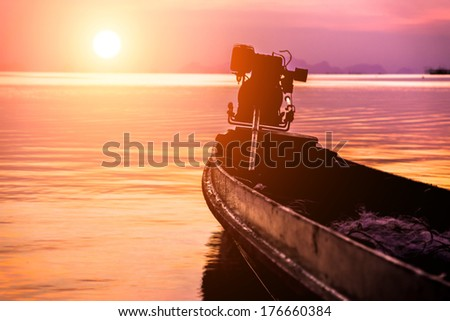 silhouettes on sunset sky beautiful lagoon - stock photo