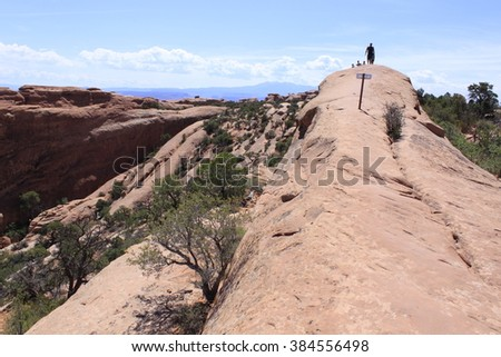 Silhouettes on The Fins trail, Arches National Park - stock photo
