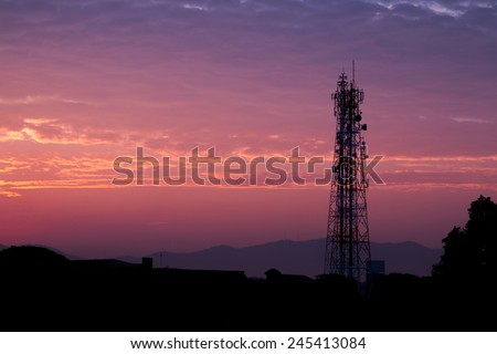 Silhouettes telecommunication tower at sunrise and twilight sky. - stock photo