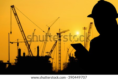 Silhouettes woman of workers on a background of Construction