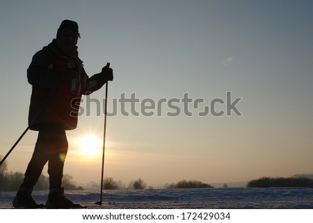 Silhoutte of people doing wintersport. - stock photo