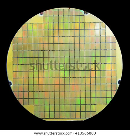 Silicon wafer with chips isolated on black background - stock photo