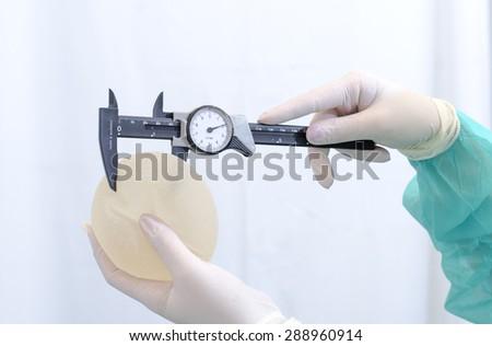 Silicone breast implant - stock photo