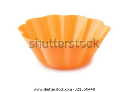 Silicone cupcake mould isolated on white - stock photo