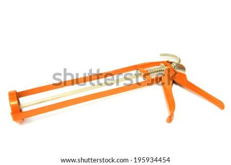 Silicone glue gun isolated on white - stock photo