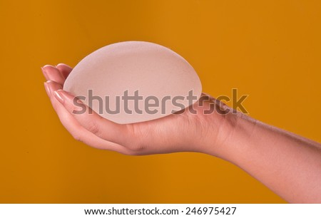 Silicone implants on hand