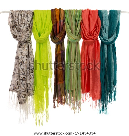 Silk colored scarves on a hanger. Isolate on white. - stock photo