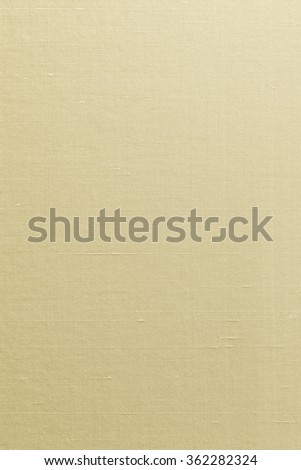Silk cotton linen blended fabrics textile textured background in light yellow cream beige gold color tone: Flax satin cloth detail pattern wallpaper backdrop canvas in creme sepia brown toned colour   - stock photo