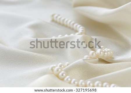 silk fabric with pearls - luxury background - stock photo