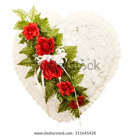 Silk funeral flower arrangement in broken heart design - stock photo