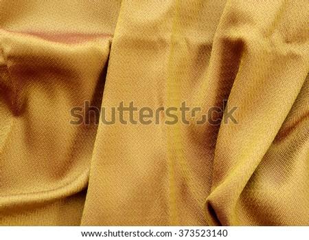 silk golden fabric texture - stock photo
