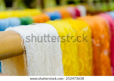 Silk Production Process, Silkworm cocoons.Colorful raw silk thread  in country of asia