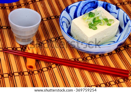 Silken tofu with soy sauce and sesame oil decorate with spring onion and ginger - stock photo
