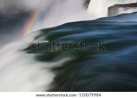 Silky American Falls, with rainbow background. Long exposure