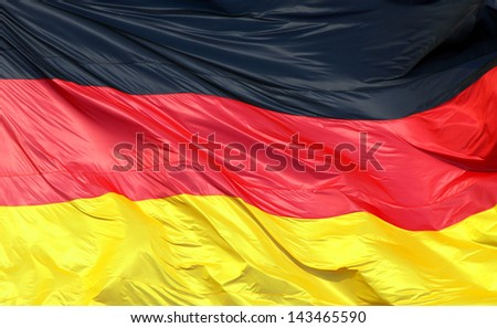 Silky flag of Germany flying in the wind - stock photo