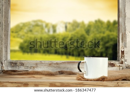 sill with mug and landscape