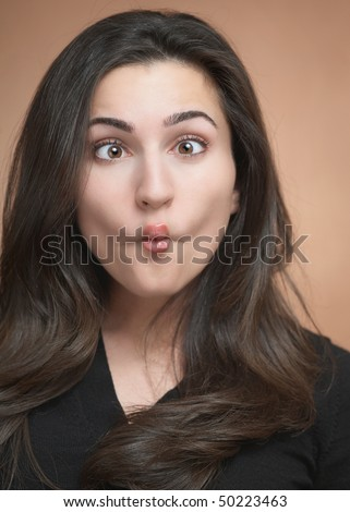 Silly funny face expression beautiful young woman - stock photo
