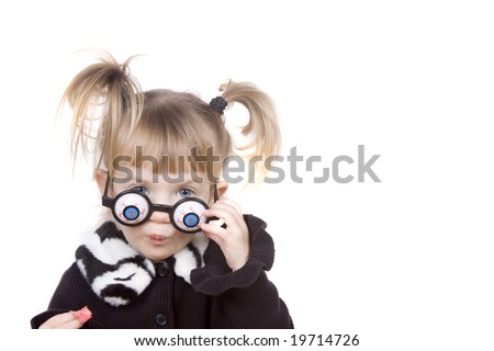Silly little girl with play eyeball glasses