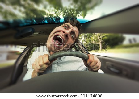 Silly man gets into car crash and makes ridiculous face - stock photo