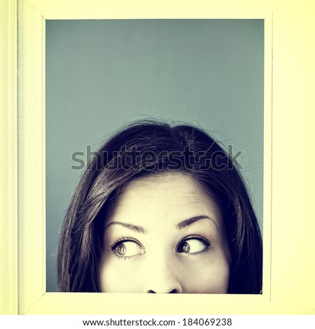 Silly woman peeking out from a white vintage picture frame, instagram style