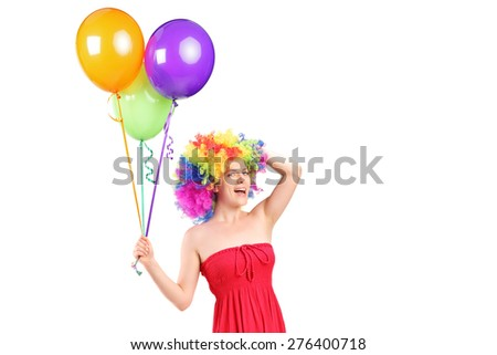 Silly woman with wig holding balloons isolated on white background - stock photo
