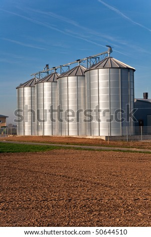 silo and acre in beautiful light with clear sky