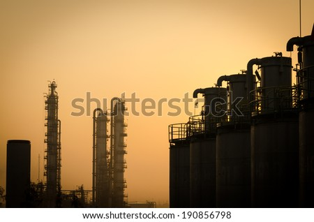 silo and column tower petrochemical plant at dawn - stock photo
