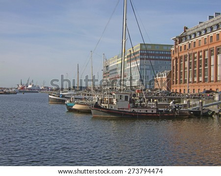 Silodam building and grain silo in Amsterdam port, Netherlands. Silodam, a colorful cubic block containing 157 apartments, was built in 2002. It is now a well known landmark of modern Amsterdam. - stock photo