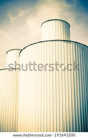 silos, blue sky, vintage - stock photo