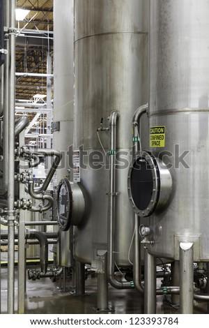 Silos in bottle industry - stock photo