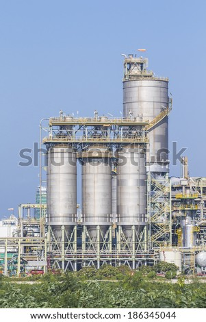 Silos in chemical factory with blue sky