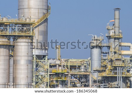Silos in chemical factory with blue sky - stock photo