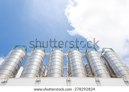 Silos of the chemical plant - stock photo