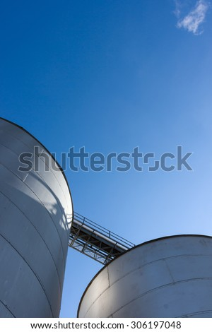 Silos set against a blue sky. - stock photo