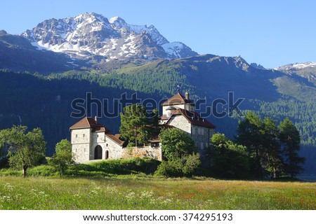 SILVAPLANA, SWITZERLAND- JUNE 25, 2015: Silvaplana Castle on the Silvaplana lake. Friedrich Nietzsche first conceived his idea of the Eternal Recurrence beside Lake Silvaplana in August 1881.