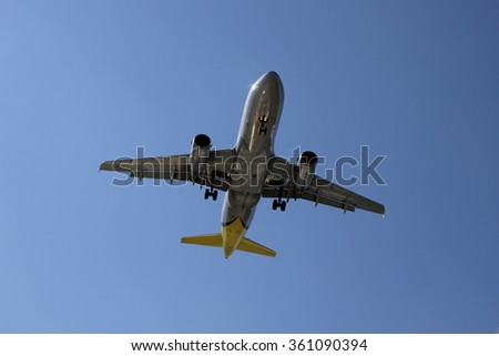 Silver airplane fuselage - stock photo