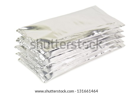 silver aluminium packagings on white - stock photo