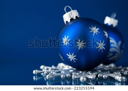 Silver and blue christmas ornaments on dark blue background with space for text. Xmas theme. - stock photo