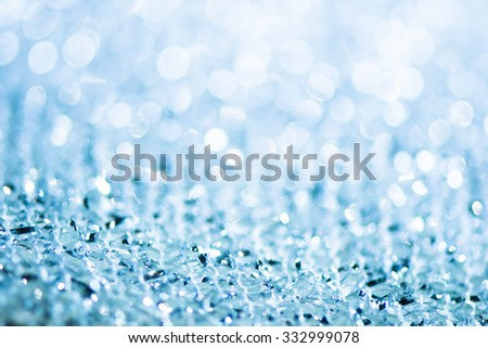 silver and blue Sparkling Lights Festive background with texture. Abstract Christmas twinkled bright background with bokeh defocused lights - stock photo