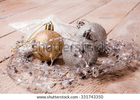 Silver and Gold Christmas Balls on the wood floor. - stock photo