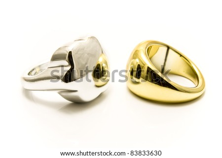 Silver and gold rings isolated on white