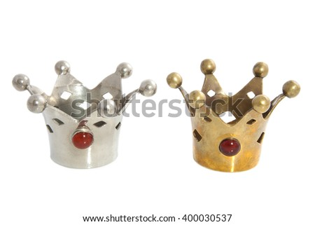 Silver and golden crowns with gems isolated over white