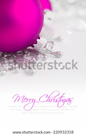 Silver and purple christmas ornaments on bright holiday background with copy space. Merry xmas! - stock photo