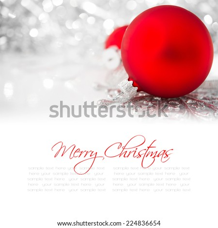 Silver and red christmas ornaments on bright holiday background with copy space. Merry christmas card. Winter holidays. Xmas theme. - stock photo