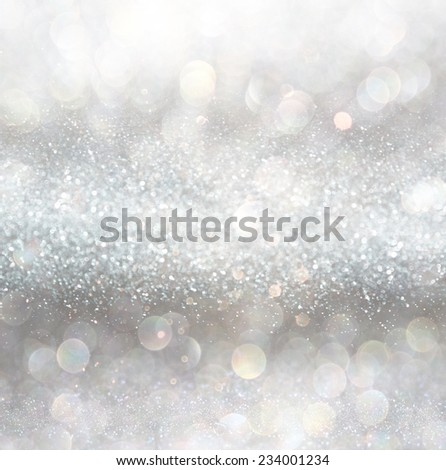 silver and white bokeh lights defocused. abstract background