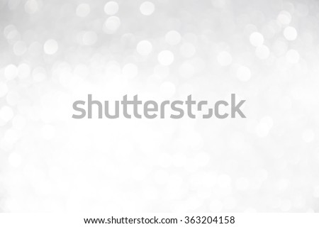 silver and white bokeh lights defocused. abstract background - stock photo