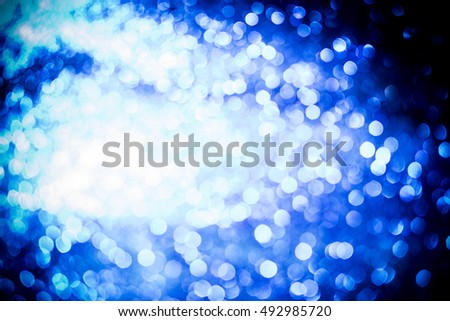silver and white bokeh lights defocused. abstract background.  glitter texture christmas abstract background.