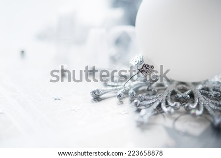 Silver and white christmas decoration on holiday background. Merry xmas card. - stock photo