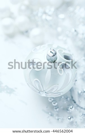 Silver and white Christmas ornaments (close up) - stock photo